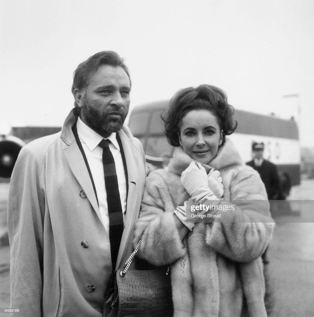 Welsh stage and film actor Richard Burton (1925 - 1984) with his wife, actress Elizabeth Taylor at London Airport.