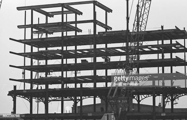 Silhouettes of construction workers can be seen on I beams as Tower Two of the World Trade Center is erected in the winter of 1970