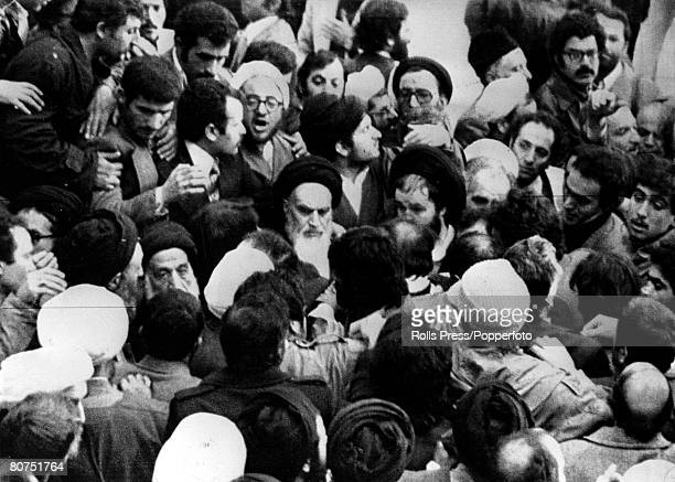 1st February 1979 Iranian opposition leader Ayatollah Khomeini pictured with turbaned Moslem marshals as he arrives in Tehran