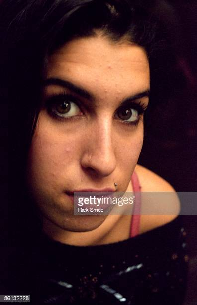 English singer Amy Winehouse posed in a launderette on Camden Parkway North London in February 2003