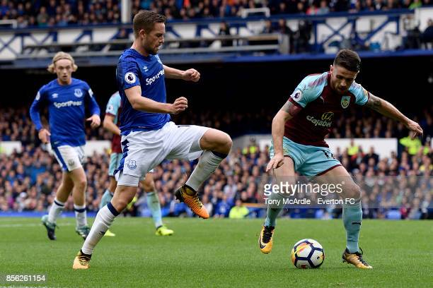 Gylfi Sigurdsson of Everton and Robbie Brady challenge for the ball during Premier League match between Everton and Burnley at Goodison Park on...