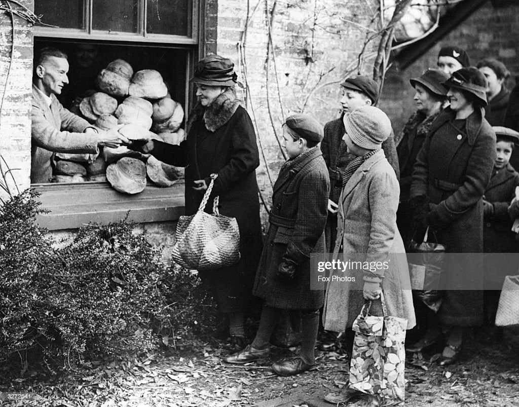 The Rev H Horton distributing the bread to the poor in his parish of Winstead in the New Forest on New Year's Day. It is a 300-year old custom.