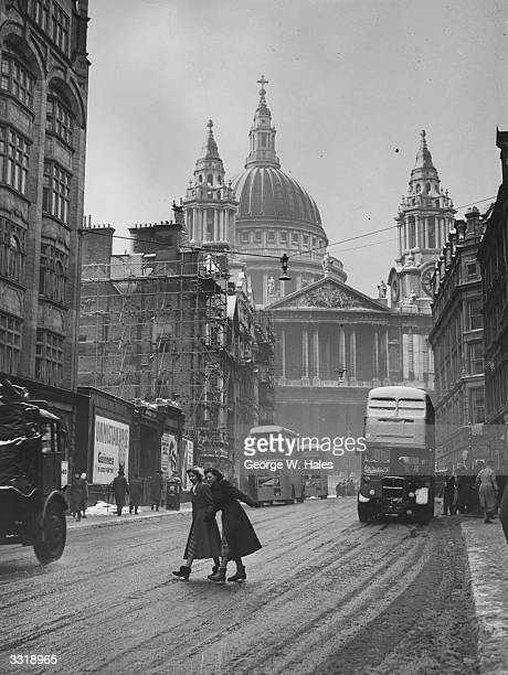 Ludgate Hill and St Paul's Cathedral in London receive a light coating of snow