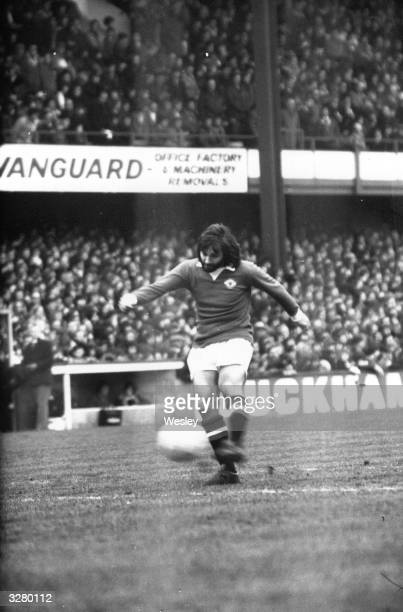 Northern Irish football player George Best in action for Manchester United against Queens Park Rangers at Loftus Road