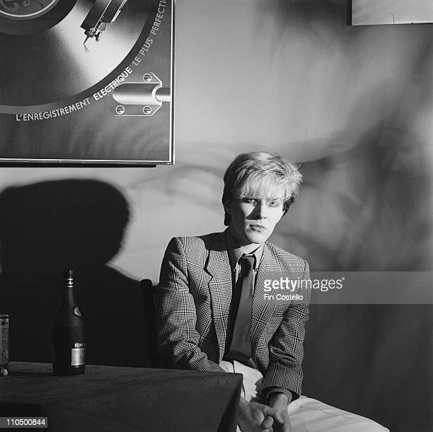 David Sylvian from Japan posed sitting at a table in London in January 1982