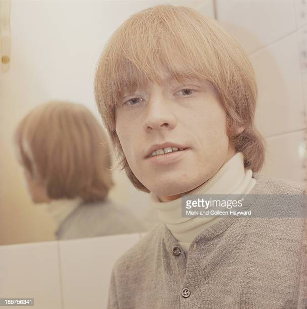 English guitarist and member of The Rolling Stones Brian Jones posed backstage in 1965