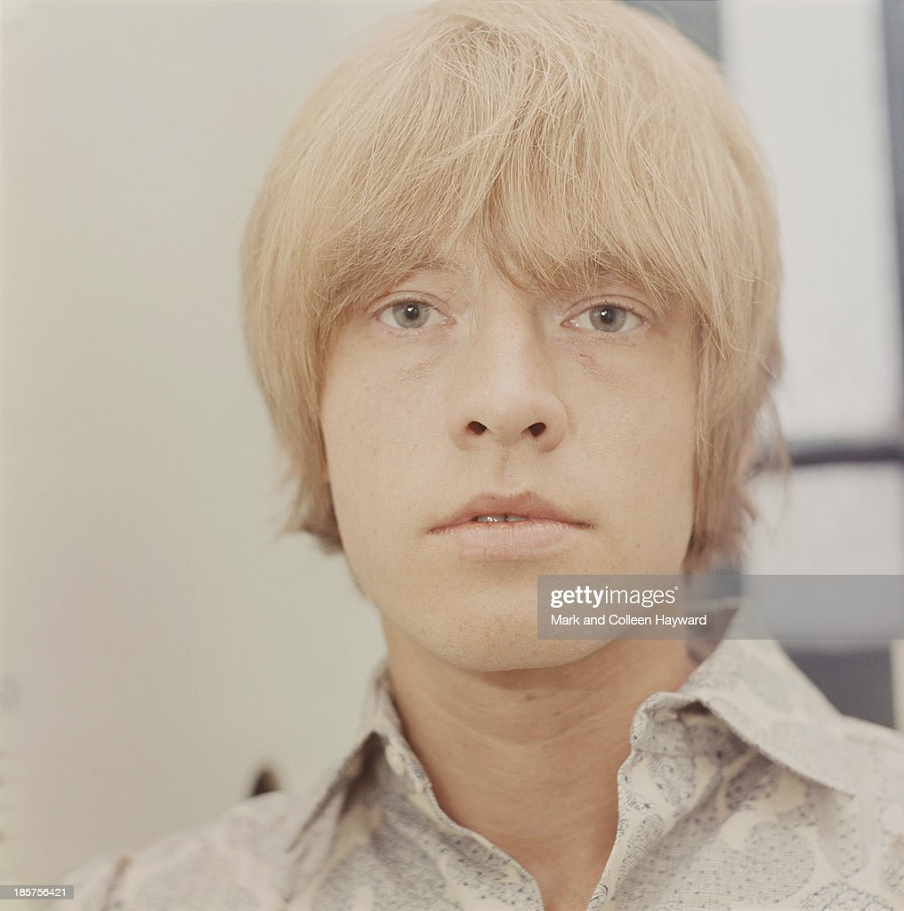 English guitarist and member of The Rolling Stones Brian Jones (1942 - 1969) posed backstage in 1965.