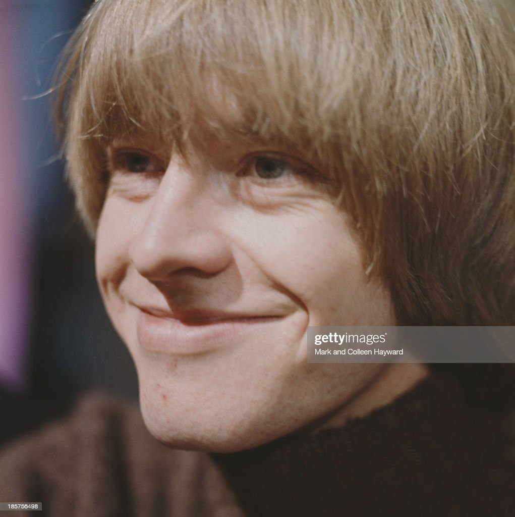 English guitarist and member of The Rolling Stones Brian Jones posed backstage in 1964