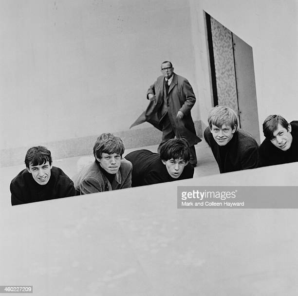 English rock and roll group The Rolling Stones posed by a subway in London in 1963 Left to right Bill Wyman Mick Jagger Keith Richards Brian Jones...
