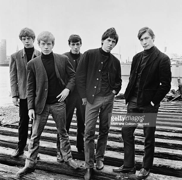 English rock and roll group The Rolling Stones posed by the river Thames in London in 1963 Left to right Mick Jagger Brian Jones Bill Wyman Keith...