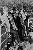 English rock and roll group The Rolling Stones posed on a boat on the river Thames in London in 1963 Left to right Brian Jones Keith Richards Charlie...