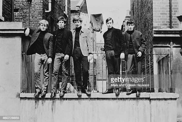 English rock and roll group The Rolling Stones posed standing on a wall in London in 1963 Left to right Brian Jones Keith Richards Mick Jagger...