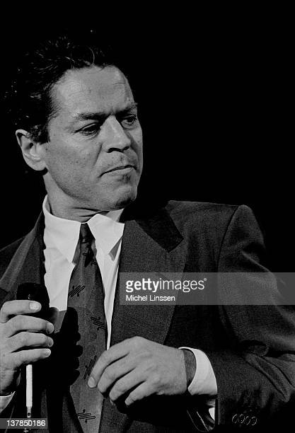English singer Robert Palmer performs live on stage in The Netherlands in 1990
