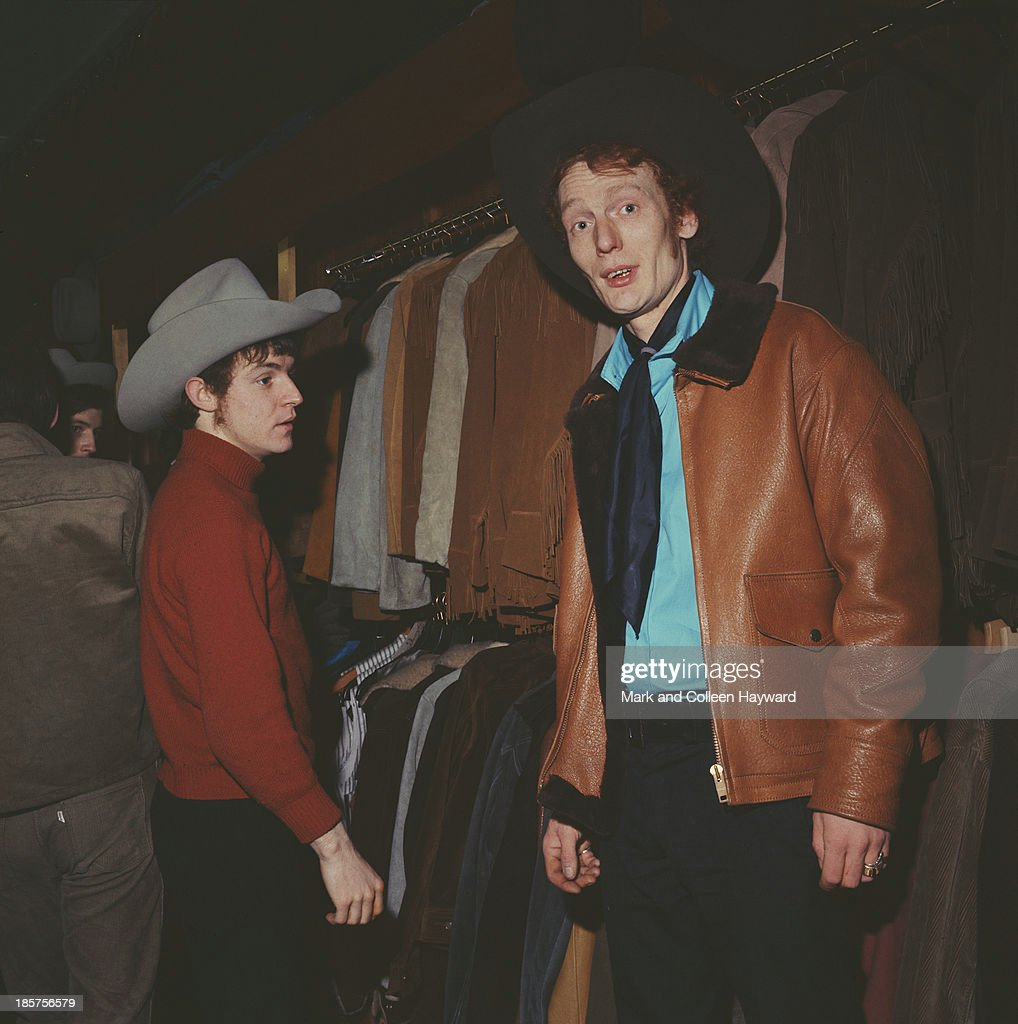 Jack Bruce (left) and Ginger Baker (right) from British rock group Cream posed in a London clothes shop in 1966. Bass player Jack Bruce wears a stetson style hat while drummer Ginger Baker wears a leather jacket and neck scarf.