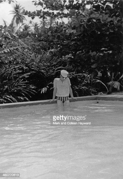 John Lennon from The Beatles posed entering a swimming pool on holiday in Port Of Spain Trinidad in January 1966