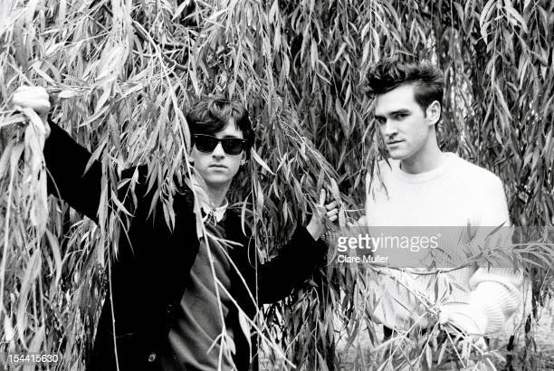 Johnny Marr and Morrissey from The Smiths pose under the branches of a willow tree in London in 1983