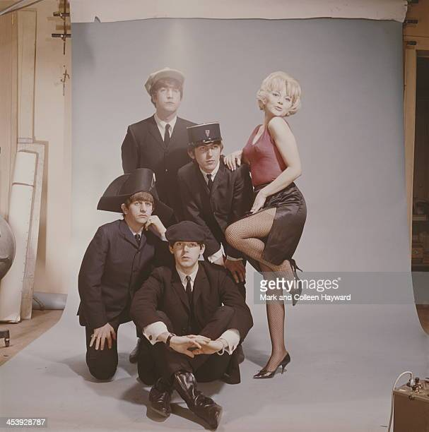 The Beatles posed with a female model and wearing appropriate Gallic hats in Paris in January 1964 Clockwise from top John Lennon George Harrison...