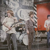 The Rolling Stones perform on the set of 'Ready Steady Go' TV show in London in 1964 Left to right Brian Jones Charlie Watts Mick Jagger and Keith...