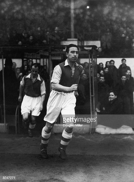 Cricketer Denis Compton trying out for Arsenal reserves during a game against Fulham at Highbury in north London