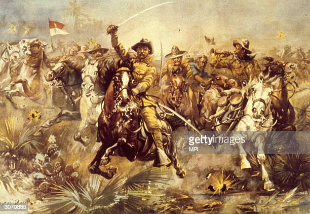 American politician and later President Theodore Roosevelt leading his 'rough riders' unit San Juan Hill during the Spanish American War Painting by...
