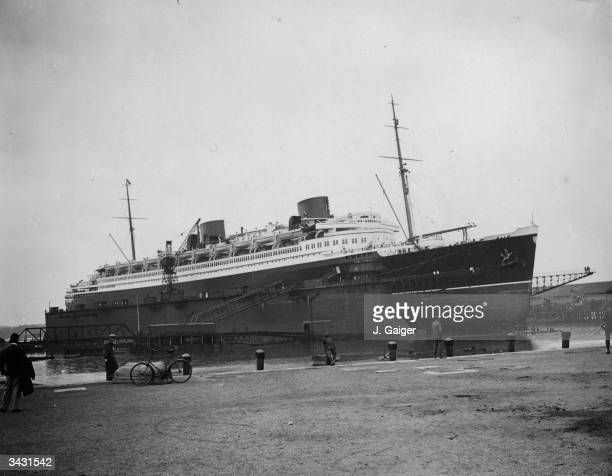 German liner the 48000 ton 'Bremen' in a floating dock at Southampton where she will have her hull painted