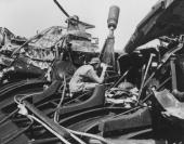 The deck of the USS Skate after an atomic bomb test at Bikini Atoll in the Pacific The sailor is testing for radioactivity