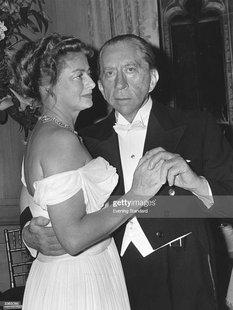 American oil executive and financier John Paul Getty (1892 - 1976) with Mary Teissier at a party at his home Sutton Place, Surrey.