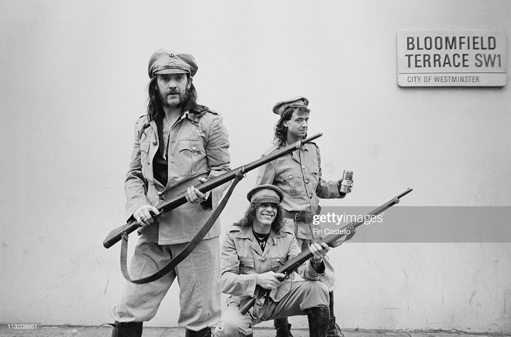 Motorhead pose in military uniforms for a photo session for the 'Killed By Death' single cover in Pimlico, London in July 1984. Left to Right: Lemmy, Mick 'Wurzel' Burston, <a gi-track='captionPersonalityLinkClicked' href=/galleries/search?phrase=Phil+Campbell+-+Mot%C3%B6rhead&family=editorial&specificpeople=227964 ng-click='$event.stopPropagation()'>Phil Campbell</a>.