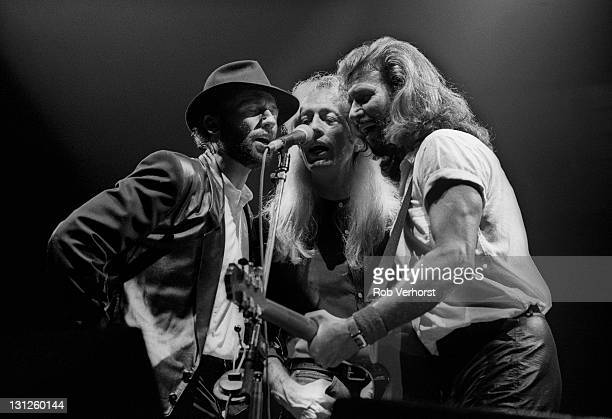 The Bee Gees perform live on stage at Ahoy in Rotterdam Netherlands on 1st July 1991 Left to right Maurice Gibb Robin Gibb and Barry Gibb