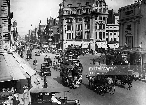 Horsedrawn and motorised traffic on Oxford St at Oxford Circus London