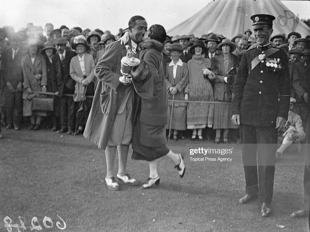 Walter Hagen American winner of the Open Golf Championship at Hoylake being congratulated by his wife