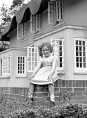 Princess Margaret Rose younger daughter of King George VI and Queen Elizabeth sits on the wall of the Welsh House at Royal Lodge Windsor