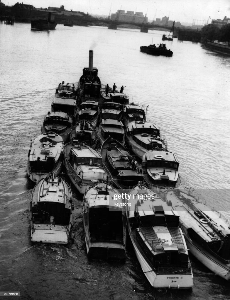 Many tiny vessels took part in the epic evacuation of the BEF and French troops from Dunkirk. A flotilla of small craft sails down the Thames on the way to France.