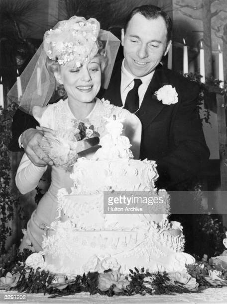 Fan dancer Sally Rand and rodeo rider Thurkel James Greenough cut their wedding cake at Glendora California