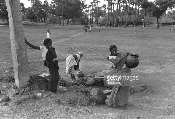 Women from an South Indian Village collect water from their village pond which provides a social focal point Original Publication Picture Post Peace...