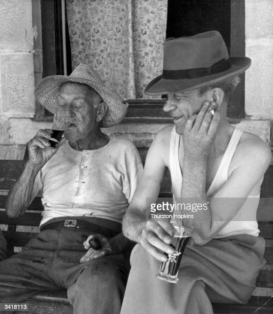Australian men enjoy a drink in the shade at Tibooburra in the Australian outback Original Publication Picture Post 6832 Flying Doctor pub 1954