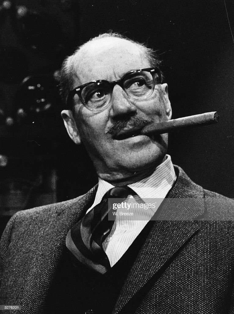 <a gi-track='captionPersonalityLinkClicked' href=/galleries/search?phrase=Groucho+Marx&family=editorial&specificpeople=206589 ng-click='$event.stopPropagation()'>Groucho Marx</a>, formerly Julius Henry Marx ( 1895 - 1977) part of comedy team The Marx Brothers, in London.
