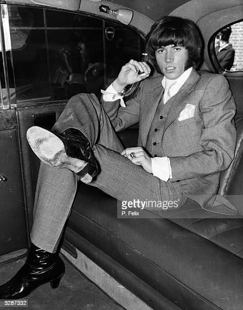 Barry Gibb of the Bee Gees pop group arrives at Uxbridge Court in the back of a chauffeur driven car he is to appear in court on a smuggling charge