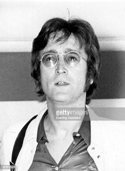 Singer songwriter and guitarist John Lennon previously of the now defunct pop group The Beatles at London Airport