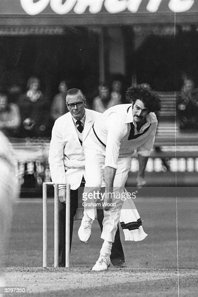 Australian fast bowler Dennis Lillee in action for Australia against Middlesex
