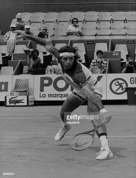 Guillermo Vilas poet and tennis player presents a powerful figure in play at Roland Garros stadium in Paris