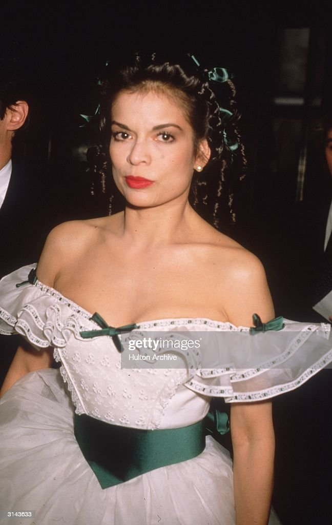 Model and human rights campaigner Bianca Jagger wearing a Scarlett O'Hara style dress to a charity auction at Christies in aid of the AIDS Crisis Fund