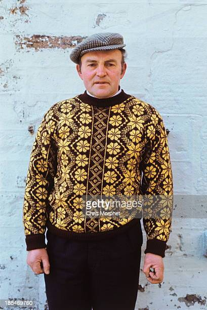 A man poses wearing a Fair Isle sweater in Lerwick Shetland Islands in June 1970
