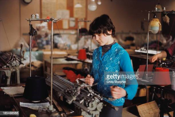 A woman operates knitting machines making Fair Isle knitwear on one of the Shetland Islands in June 1970