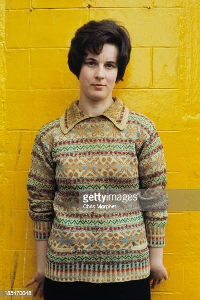 A young woman poses wearing a Fair Isle sweater in Lerwick Shetland Islands in June 1970