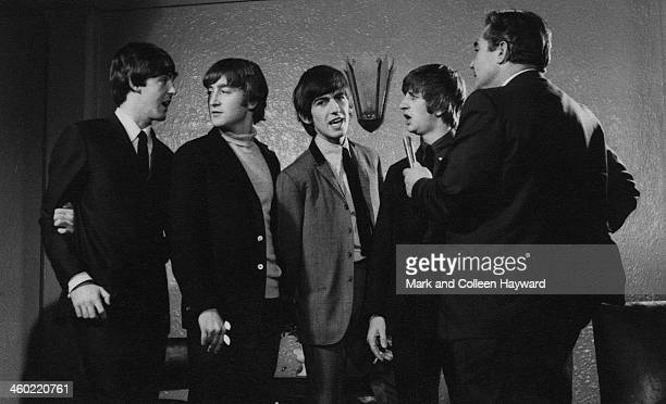 The Beatles are interviewed by a journalist during the band's tour of New Zealand in June 1964 Left to right Paul McCartney John Lennon George...