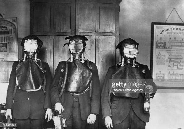 Three men dressed in Draeger smoke helmets at the time of the Hamstead Colliery disaster Great Barr Birmingham