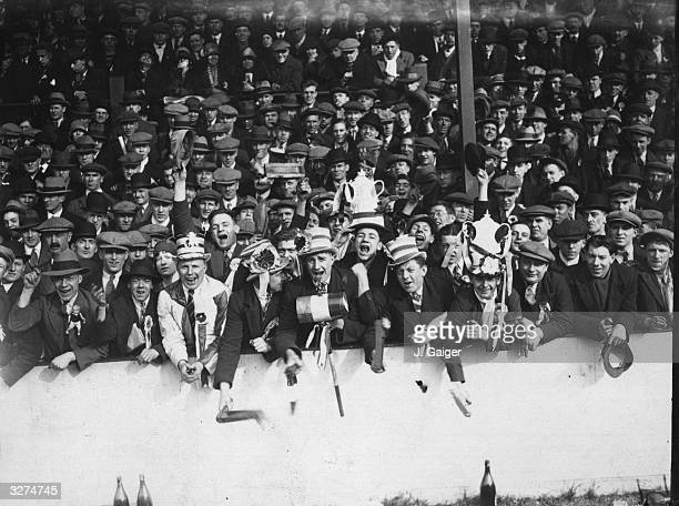 The enthusiastic supporters at a London derby match between West Ham United and Arsenal at Upton Park