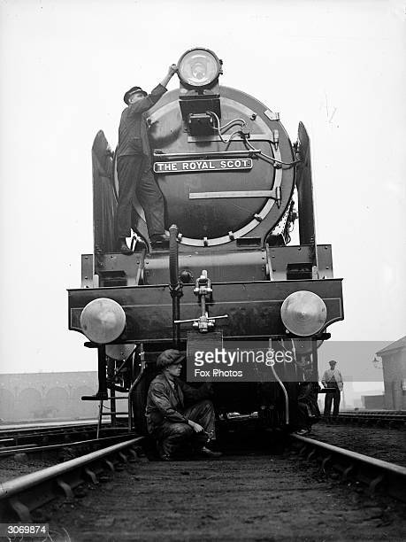 The LMS engine 'Royal Scot' receiving an overhaul from a couple of maintenance men