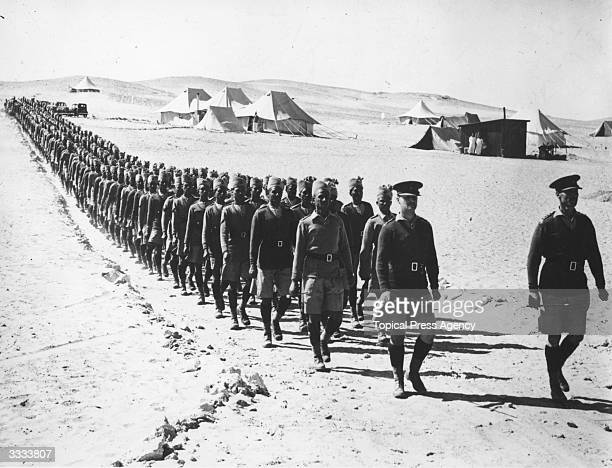 Indian troops led by British officers march out of their desert camp in Egypt The Indians were the first of the Empire troops to take up their...